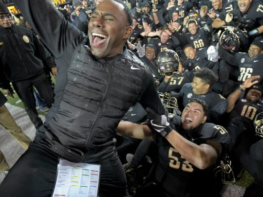 Vanderbilt coach Derek Mason celebrates his team's
