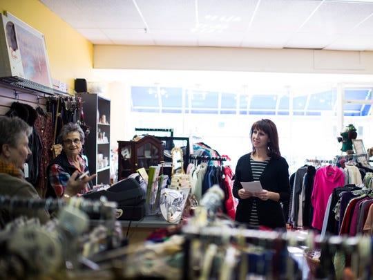 Jenn Green of Be Alined, right, speaks with volunteers Carolyn Baur, left, and Gilda Monahan inside Samaritan Thrift Friday, Jan. 13 in Haddon Township.