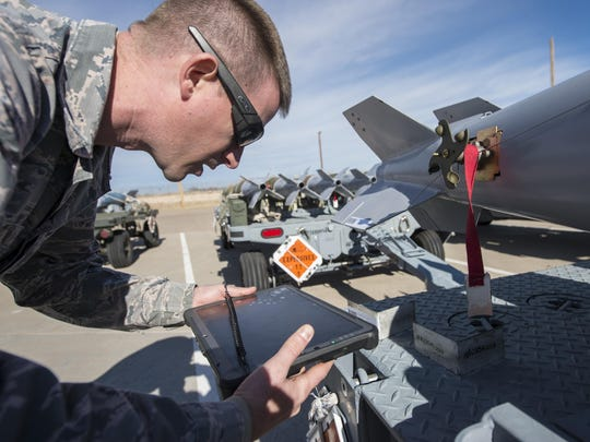 Staff Sgt. Joshua Tobin, a 49th Maintenance Squadron Munitions storage crew chief, uses a Getac tablet to scan a barcode on an asset, Jan. 9, 2017 at Holloman Air Force Base, N.M. The tablets are in the implementation phase, and are able to input information in real-time, significantly cutting down job times.