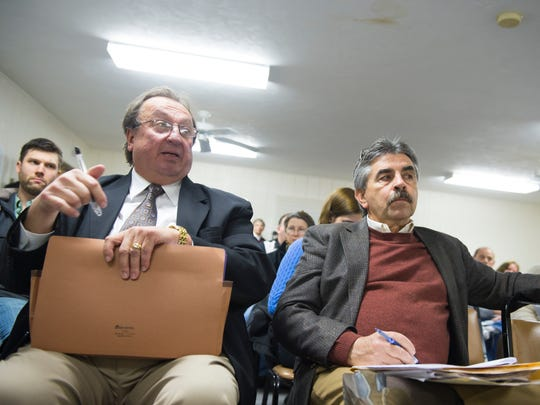 Bernie Yannetti (left), an attorney for businessman David LeVan, and Robert Sharrah (right), president of Sharrah Design Group, respond to inquiries about a proposal to build a casino and racetrack in Freedom Township during a zoning hearing on Thursday.