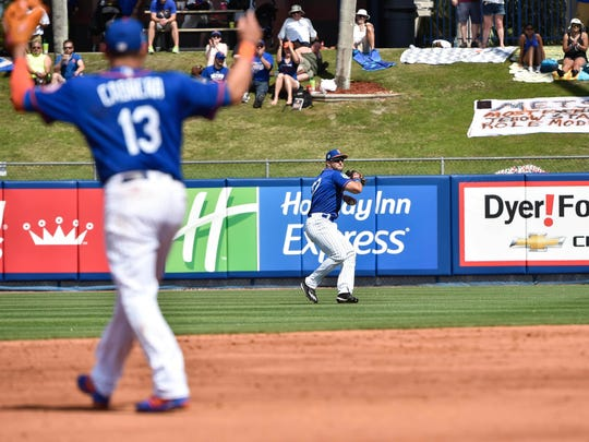 Mets right fielder Tim Tebow (97) throws the ball in