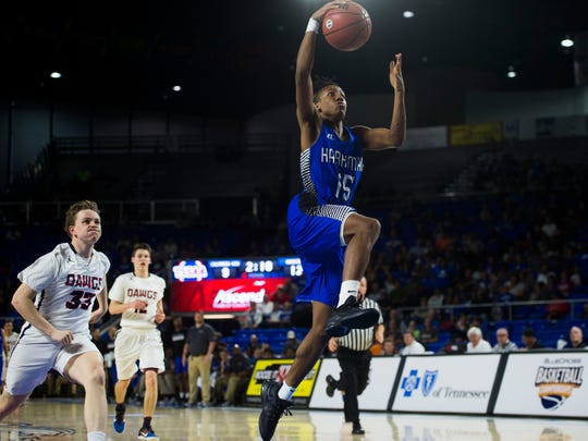Harriman's Isaiah McClain drives for a layup against Columbia Academy during a Class A semifinal game Friday at Middle Tennessee State University  in Murfreesboro.
