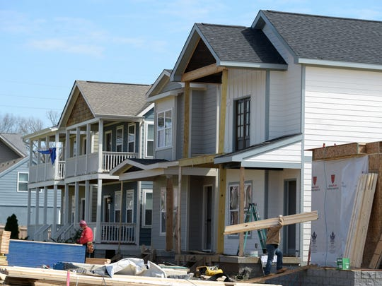 Construction workers build new homes on Illinois Ave.  The neighborhood know as the Nations is changing rapidly with new home construction and renovation to old business buildings.