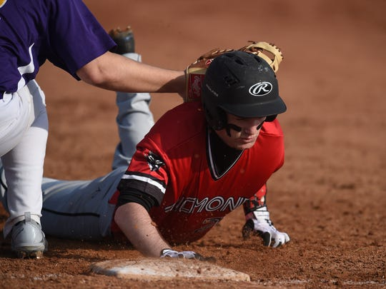 Richmond's Austin Turner tries to avoid a tag from