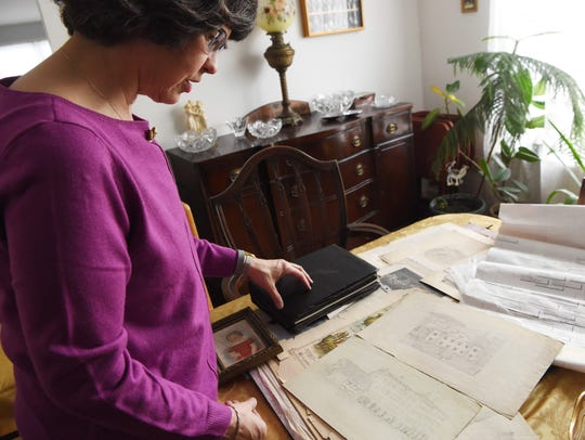 Toni Houston goes over some familial artifacts in her