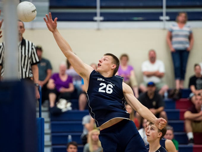 West York's Kenton Meckly (26) taps the ball over the