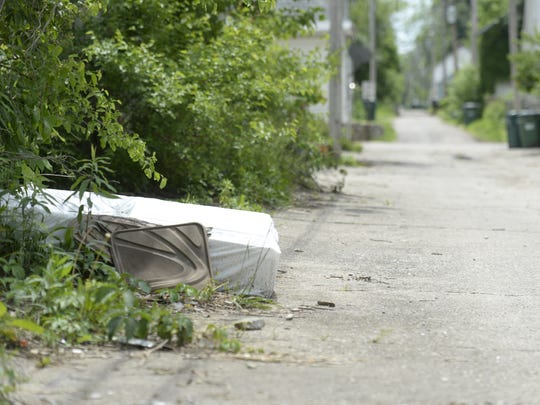 Debris lays in the alley between South 12th and South 13th streets in Richmond.