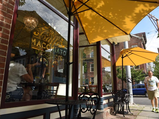 A view of the outside of Caffe Macchiato, located on