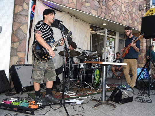 The band Knock Yourself Out performs outside of My Place Pizza on Main Street in the City of Poughkeepsie as part of O+ Poughkeepsie.
