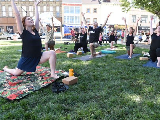 Meghan Conway, co-founder of Yoga Centro, leads a yoga class in Mural Sqaure in the City of Poughkeepsie during the 2017 O+ Poughkeepsie.