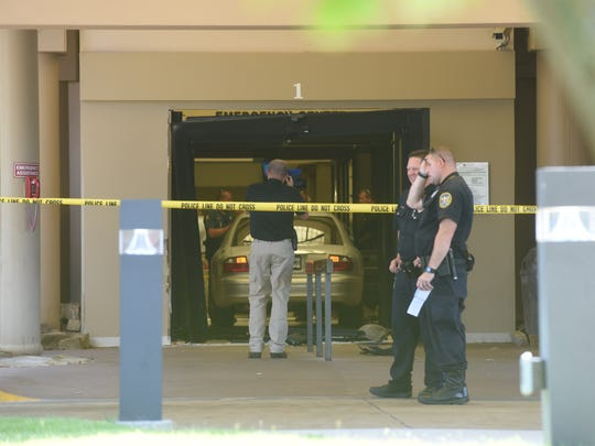 Police investigate Friday at Baxter Regional medical Center after high-speed pursuit suspect Rory Gregory crashed through the emergency room doors.