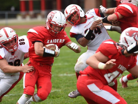 Red Hook's Tanner Guidi, center, tries to weave through