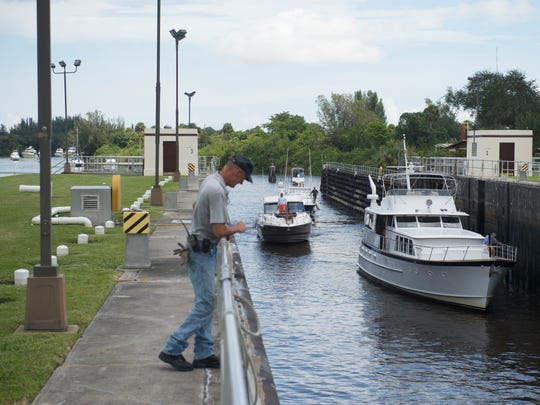 "A steady stream of boats moving west, hoping to find a secure spot during Hurricane Irma, filtered through the St. Lucie Lock and Dam on Wednesday in Stuart. ""There's no good place, right?"" said boat captain Ted Doran (not pictured), as he moved his craft to stay in Indiantown during the storm."