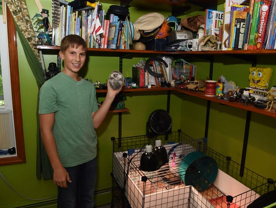 Bradley Jurain, 13, holds his pet hedgehog Pepper in