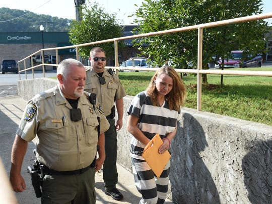 Rebecca Ruud, right, is escorted by deputies Monday