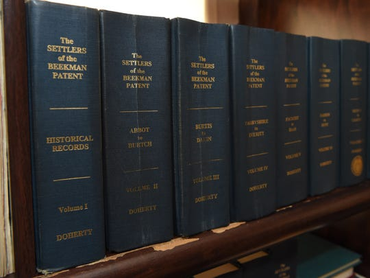 A view of several of the volumes Frank Doherty has written about the the settlers of the Beekman Patent, seen in his home office in LaGrange.