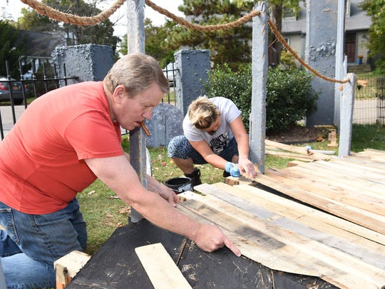 Bill Mahlmeister, left, and Marisol Mahlmeister, right, work on putting together their Halloween display at their home in Fishkill.