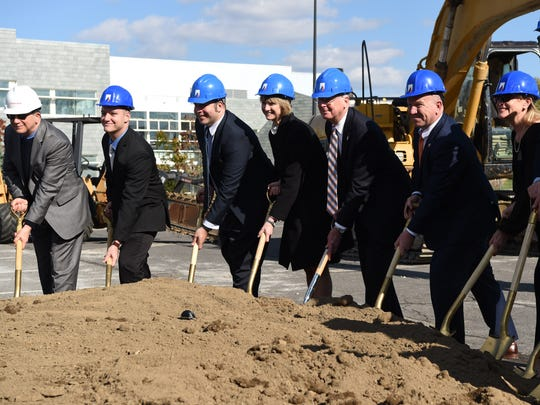 SUNY Chancellor Kristina Johnson, fourth from left,