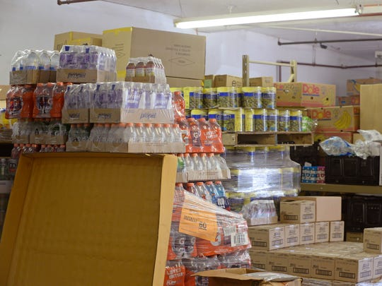 Stockpiles of food and other items sit in the warehouse