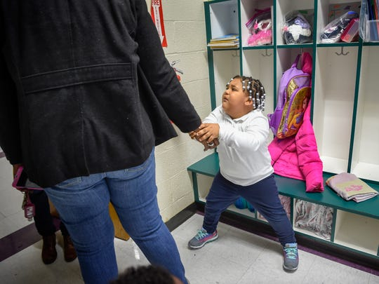 Quinta Sanders pulls away from her granddaughter Teh'erria as she drops her off for preschool at the Hull Jackson Montessori School in Nashville on Thursday, Nov. 9, 2017. Ever since Teh'erria's father was killed she has been afraid that something will happen to her grandmother.