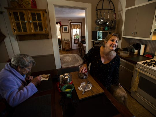 Lauren Mohan of Benson prepares lunch for her 90-year-old mother who suffers from Alzheimer's disease and lives with her.