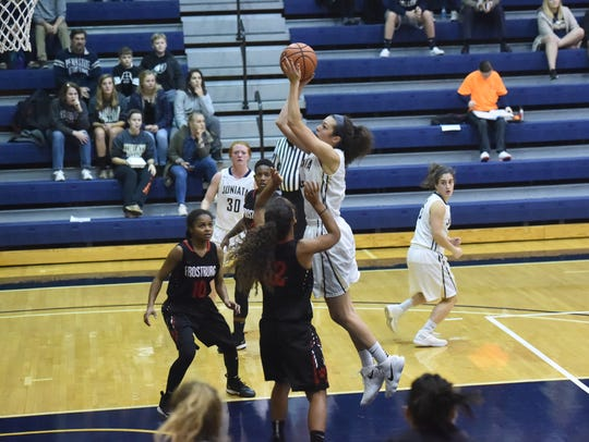 Dallastown High School graduate Rachael Anstine is seen here taking a shot for the Juniata College women's basketball team.