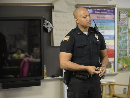 Officer Tim Davis talks to students about obeying the