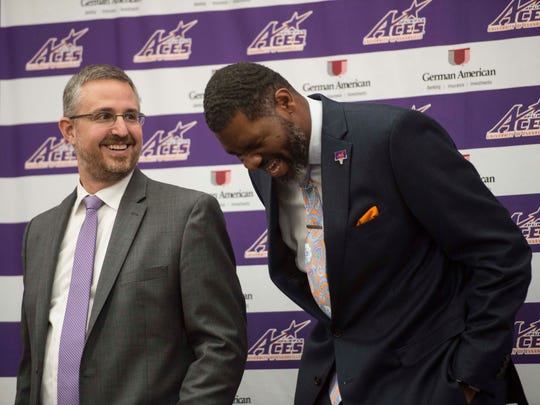 University of Evansville athletics director Mark Spencer (left) jokes with men's basketball head coach Walter McCarty during his introduction at Meeks Family Fieldhouse last March.