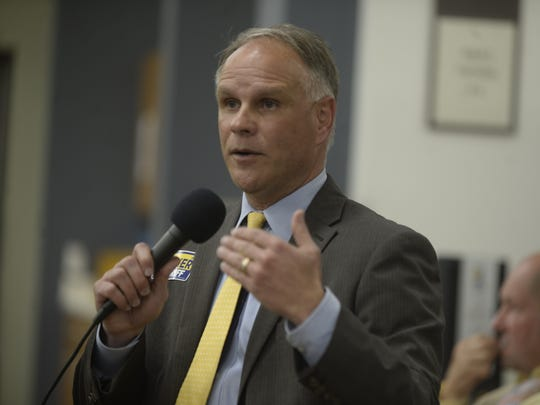 Todd Barker speaks during Tuesday's candidate forum at the Cambridge City library.