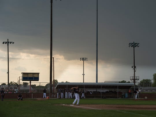 A storm rolls in during a baseball game between Harrison