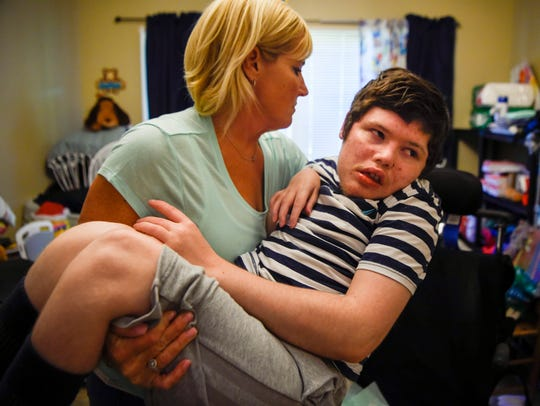 Michelle Sampson picks up her 21-year old son Dalton,