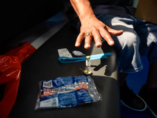 Thomas Gooch, who runs StreetWorks' syringe exchange program, hands out clean needles, cotton balls, alcohol swabs and small metal cookers to any addict in need. The program is intended to stop addicts from spreading blood-borne diseases with dirty needles.