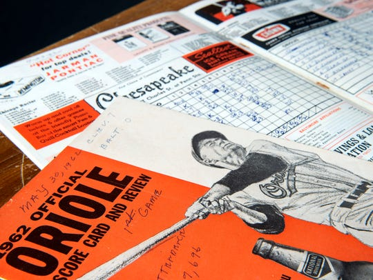 This Father's Day is most bittersweet. Alzheimer's disease has stolen my Dad's memories and baseball lessons he passed on to me. So I cherish seeing his writing in these game programs from more than 50 years ago. That one from 1966? The O's No. 2, 3 and 4 hitters were Boog Powell, Frank Robinson and Brooks Robinson.