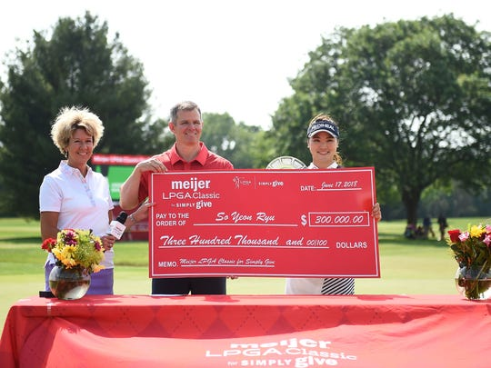 So Yeon Ryu poses with the winner's check following the final round of the Meijer LPGA Classic for Simply Give at Blythefield Country Club  on June 17, 2018 in Grand Rapids.