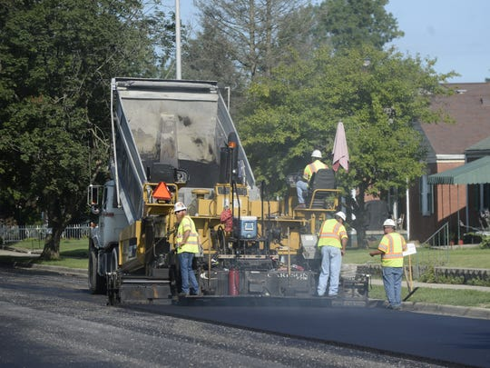 A crew works to finish paving a portion of West Main Street in Richmond last fall. The road is one of 10 that were milled and paved thanks to money from the state's Community Crossings program.