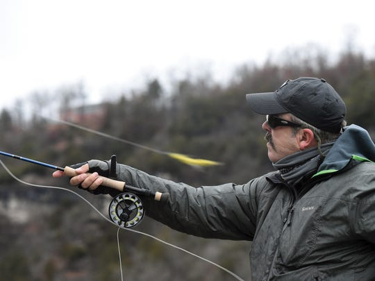 "Steve Dally casts an eight-inch streamer fly while fishing on a cold January morning. ""It's a game of a thousand casts,"" he says."