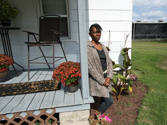 Salisbury resident Tina Spates, 59, stands outside