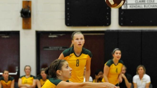 Reynolds' Emily Russell (8) and Michaela Bissinger.