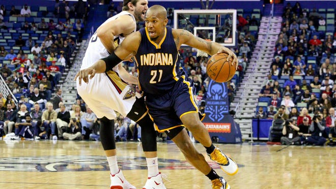 Feb 11, 2015; New Orleans, LA, USA; Indiana Pacers forward David West (21) drives past New Orleans Pelicans center Jeff Withey (5) during the first quarter of a game at the Smoothie King Center. Mandatory Credit: Derick E. Hingle-USA TODAY Sports