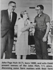 John Page Holt, left, and his wife, O'Delle Holt, talk with farm manager Douglas Waggoner.