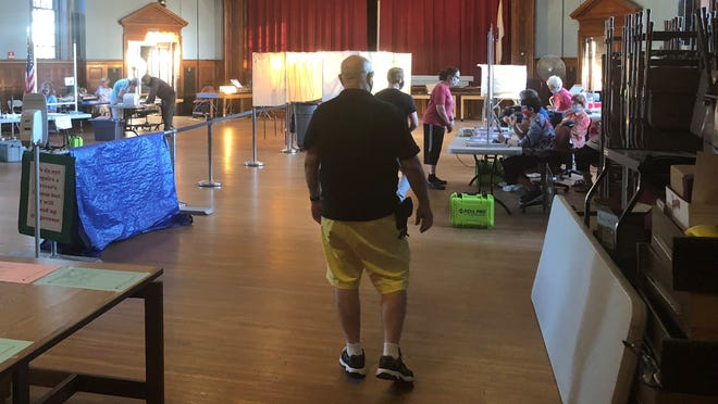 The flow of voters was said to be steady Tuesday, though a large chunk of Wareham's registered voters had their votes already collected and ready for counting.