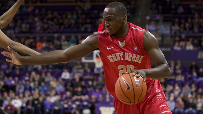 Stony Brook Jameel Warney dribbles the ball during the first half of an NCAA college basketball game against Washington Sunday, Dec. 28, 2014, in Seattle. Stony Brook won 62-57.