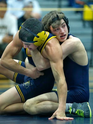 113 Lb division - Matthew Caccamise of Wayne defeated Tyler Mitchell of Spencerport at Spencerport High School.
