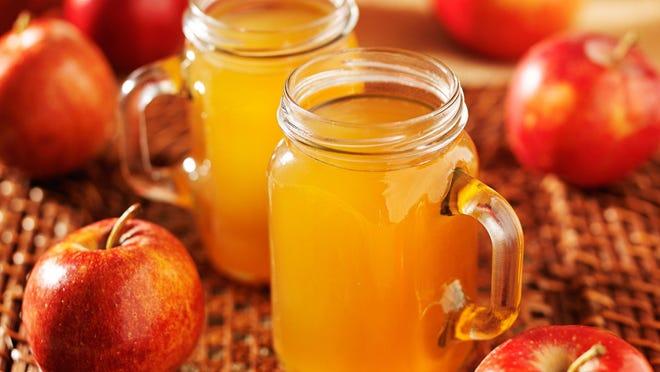 Enjoy a cup of hot apple cider in a mason jar.