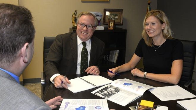 Silver Lake College President Dr. Chris Domes, center, and Brianna Neuser, right, assistant dean of the college's School of Professional Studies, smile while meeting with Marc Barbeau, SLC's vice president of advancement and external relations, to discuss the $1 million gift the college received for its new four-year nursing program.