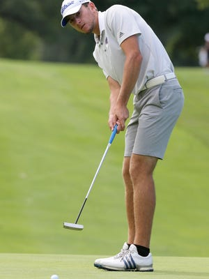 Joseph Evans of Lake putts on the first hole at Monday's Lake Invitational.