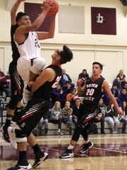 Tularosa's Joe Perez soars toward the basket during a layup attempt.