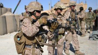 U.S. Marines patrol with Afghan soldiers in Helmand Province, Afghanistan, on June 6, 2012.