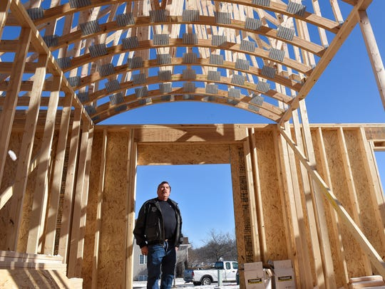 Ernie Wollak of Wollak Construction stands in the vaulted
