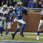 Detroit Lions' Calvin Johnson breaks a tackle after a pass reception against the Dallas Cowboys in Detroit, Michigan, on Sunday, October 27, 2013. (Julian H. Gonzalez/Detroit Free Press/MCT)